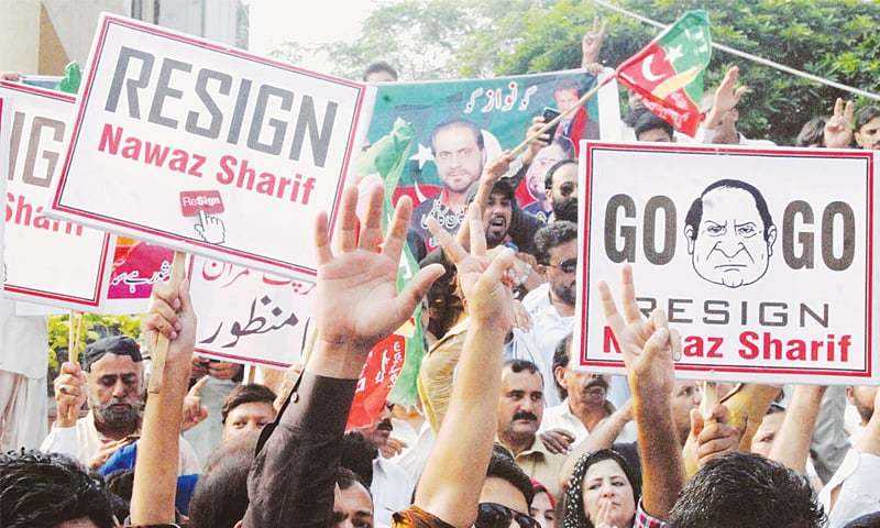 PTI workers hold a rally demanding the PM's resignation outside Rawalpindi Press Club.—INP