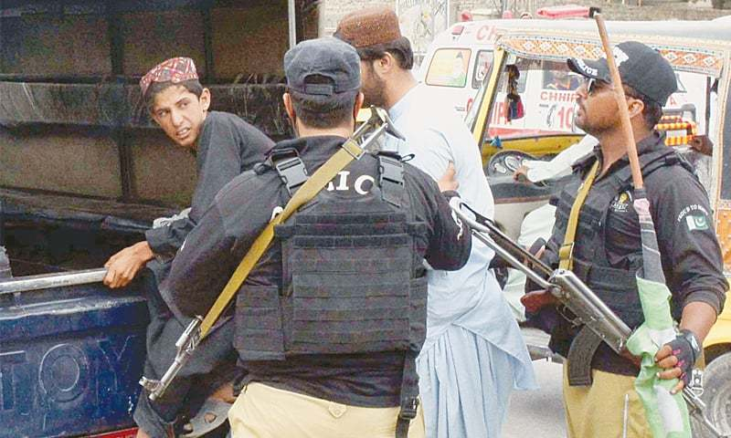 QUETTA: Policemen arrest PPP workers during a protest in front of the election commission office on Sunday.—INP