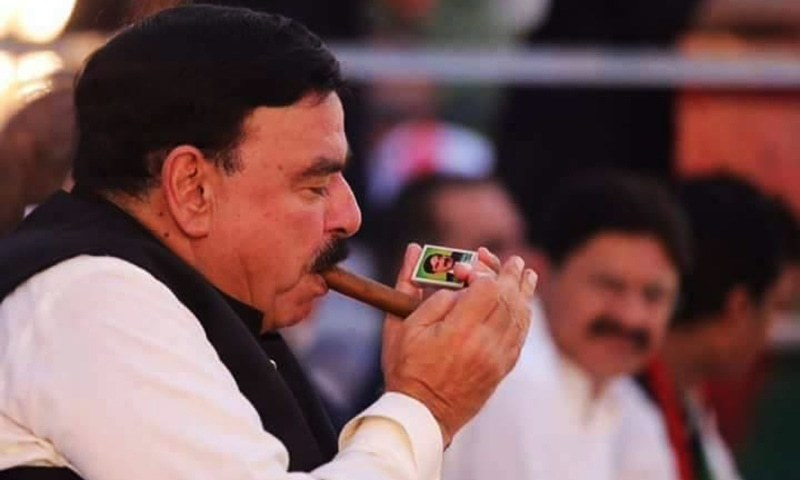 Sheikh Rashid lights up a signature cigar with matches branded with his name. — Photo Courtesy: Facebook