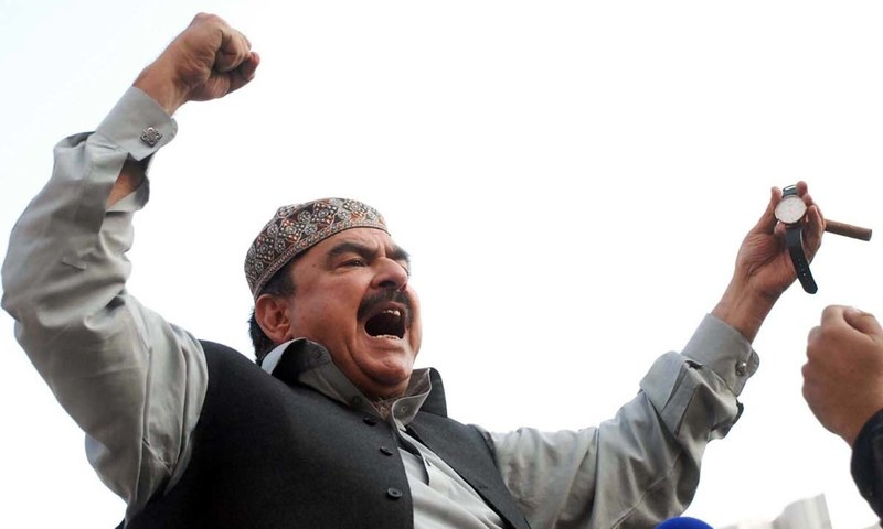 Oct 28, 2016: Sheikh Rashid gestures after his arrival at Committee Chowk in Rawalpindi after avoiding arrest by police. Photo:File