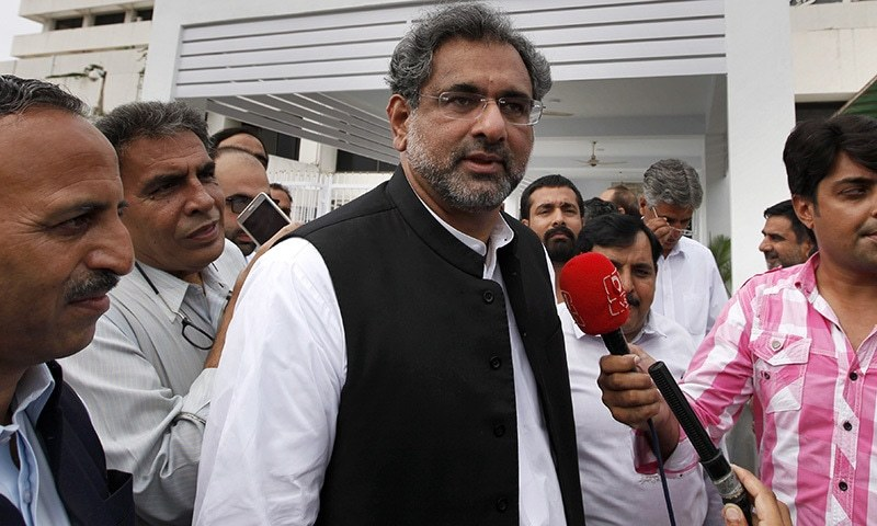 Prime Minister Shahid Khaqan Abbasi arrives at the Parliament house in Islamabad on Monday.— AP