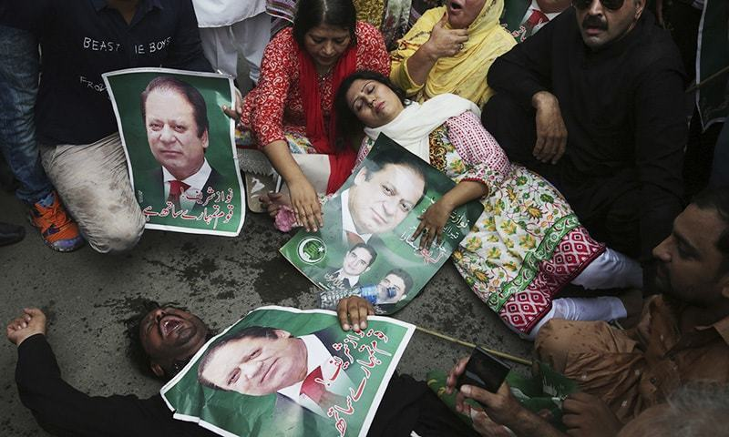 Supporters of PML-N gesture during rally to condemn the dismissal of their leader Nawaz Sharif in Lahore, Friday.— AP