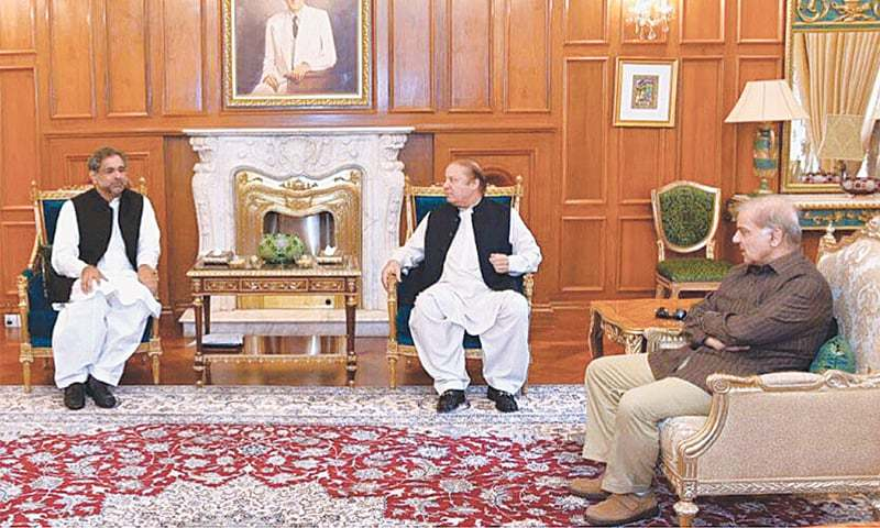 MURREE: Prime Minister Shahid Khaqan Abbasi meets his predecessor Nawaz Sharif on Wednesday. Punjab Chief Minister Shahbaz Sharif is also present.—APP