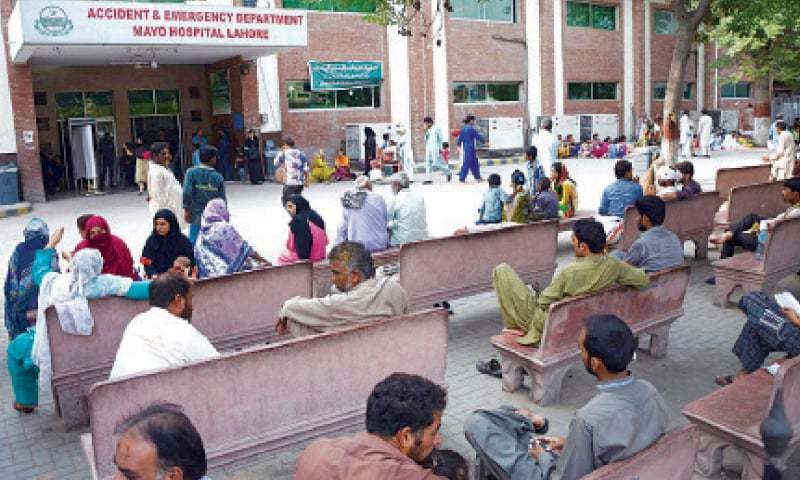 Relatives of the patients perturbed due to a strike by young doctors sit on benches outside the Mayo Hospital emergency. — Online