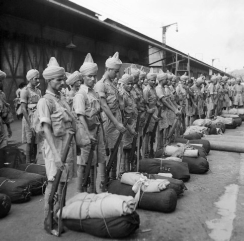 Newly arrived Indian troops parade on the quayside at Singapore, November 1941. –Source: Wikipedia