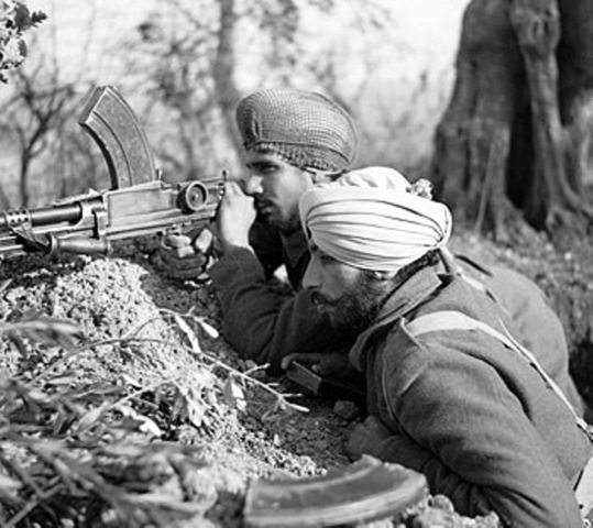 Two Sikh soldiers from the Indian Army using a Bren light machine gun in the Italian campaign near Villa Grande, 15 January 1944. –Source: Wikipedia
