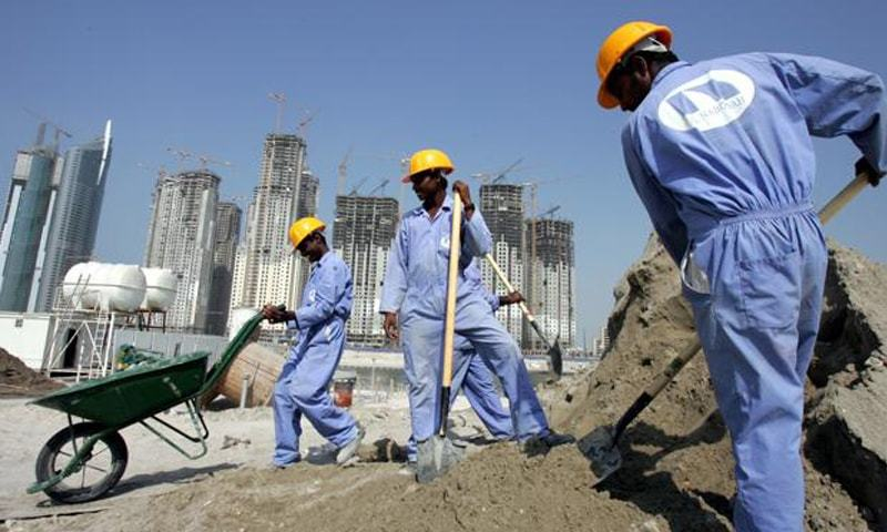 Indian expatriate labourers hard at work constructing buildings in a country they will never be able to call home | AP