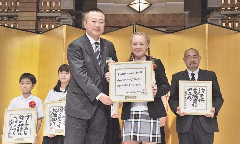 Thirteen-year-old Briton Gracie Starkey receives a framed copy of her winning haiku organised by Ito En Ltd on July 6. Starkey became the first non-Japanese to win the English haiku category, which also received the highest number of entries from 46 countries.