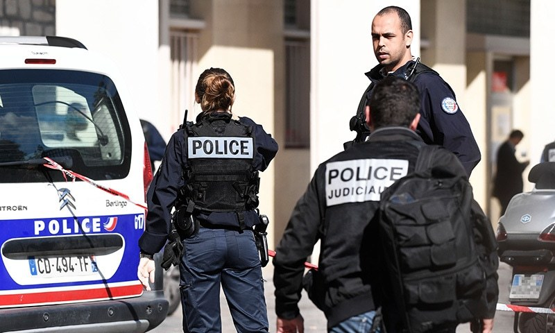 Police work at the site where a car slammed into soldiers on patrol in Levallois-Perret, outside Paris, on August 9.— AFP