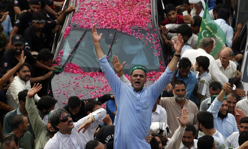 Abid Sher Ali shouts slogans while supporters wave to their leader during the rally in Islamabad. —AP