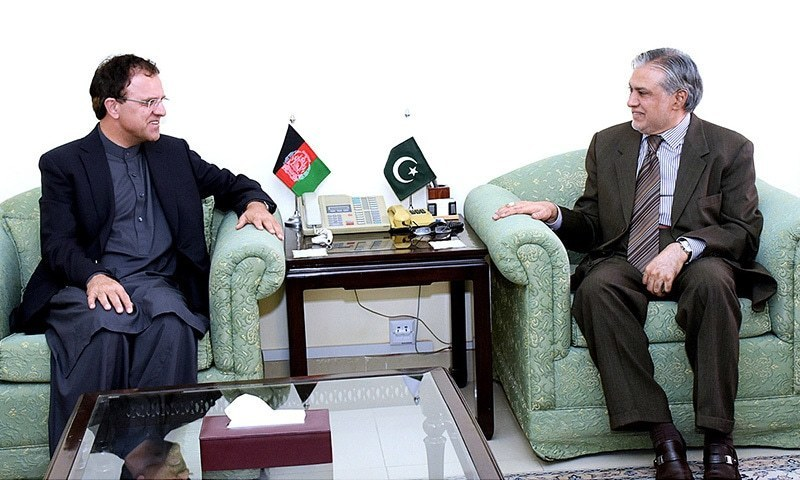 AFGHAN Ambassador Hazrat Omar Zakhilwal talking to Finance Minister Ishaq Dar on Wednesday.—APP