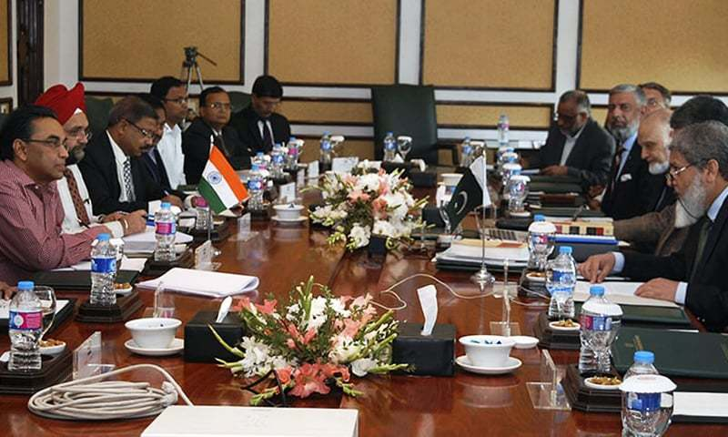 A delegation of Indian experts, headed by P K Saxena, left, holds talks with his Pakistani counter part Mirza Asif Saeed, right, in Islamabad in March 20.— AP/File