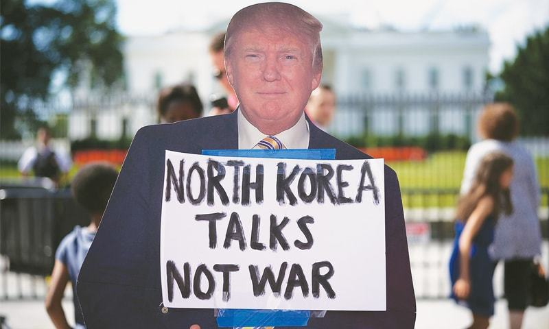 A cardboard cut-out of US President Donald Trump during a protest on Thursday in Washington, DC against escalating threats of military action in North Korea.—AFP
