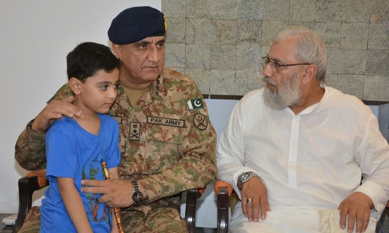 Chief of Army Staff, Gen Qamar Javed Bajwa pictured with family of Major Ali Salman on Friday. — APP