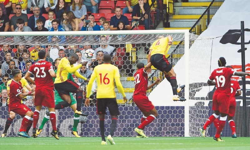 WATFORD: Watford's Stefano Okaka scores his side's opening goal against Liverpool during their English Premier League match at Vicarage Road on Saturday.─AP