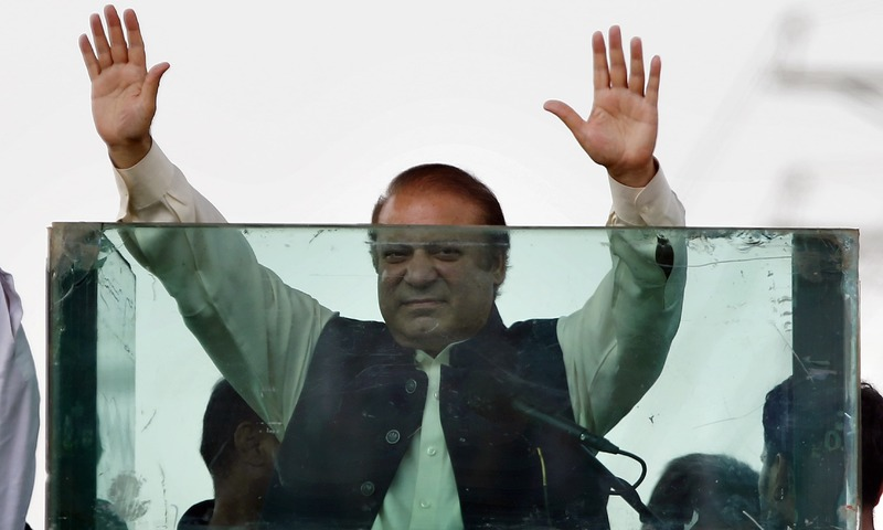 Nawaz Sharif raises his hands to respond to his supporters during a rally in Muridke on Saturday. —AP/File