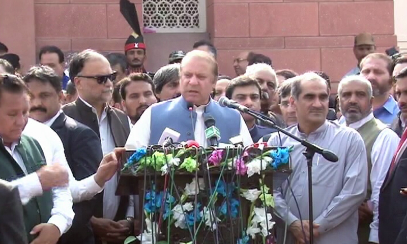 Ousted prime minister Nawaz Sharif addresses a gathering outside Allama Iqbal's mausoleum in Lahore. ─ DawnNews