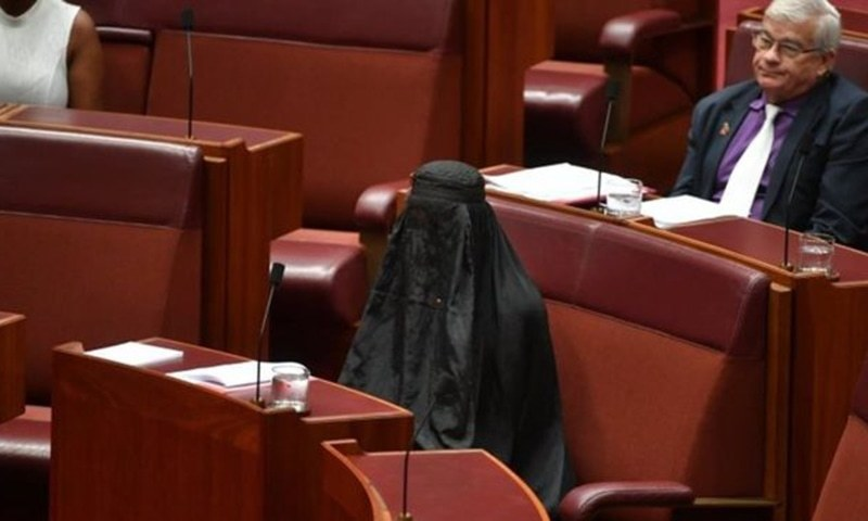 Far-right senator wears burka in parliament to create debate
