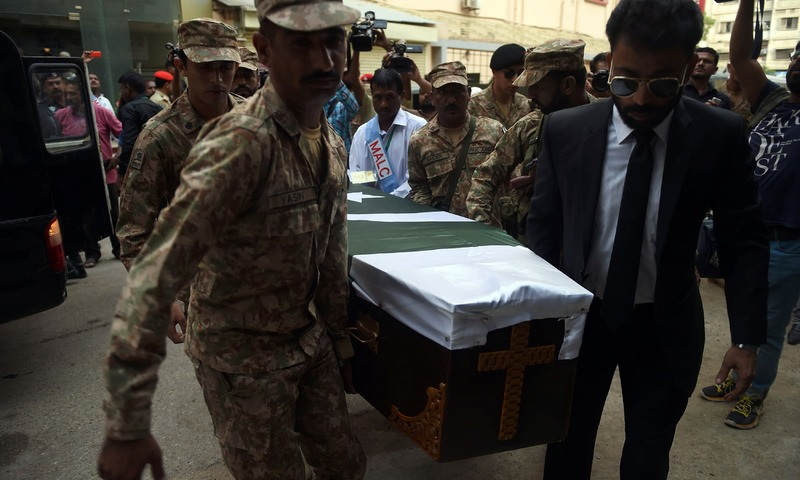 Soldiers and members of the Marie Adelaide Leprosy Centre transport the coffin of Ruth Pfau to an ambulance during her funeral ceremony in Karachi. —AFP