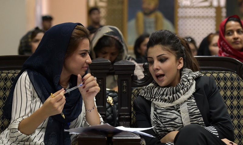 "Tahmina Arian talks with Tahmina Rashiq at the first public event for the ""Where Is My Name"" campaign in Kabul. —AFP"