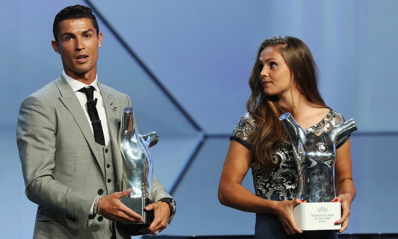 "Real Madrid's Portuguese forward Cristiano Ronaldo (L) speaks holding the trophy as Netherlands' midfielder Lieke Martens looks on after he was awarded the title of ""Best Men's Player in Europe"" and she was awarded ""Best Women's Player in Europe"" at the conclusion of the UEFA Champions League group stage draw ceremony in Monaco on August 24, 2017. —AFP"