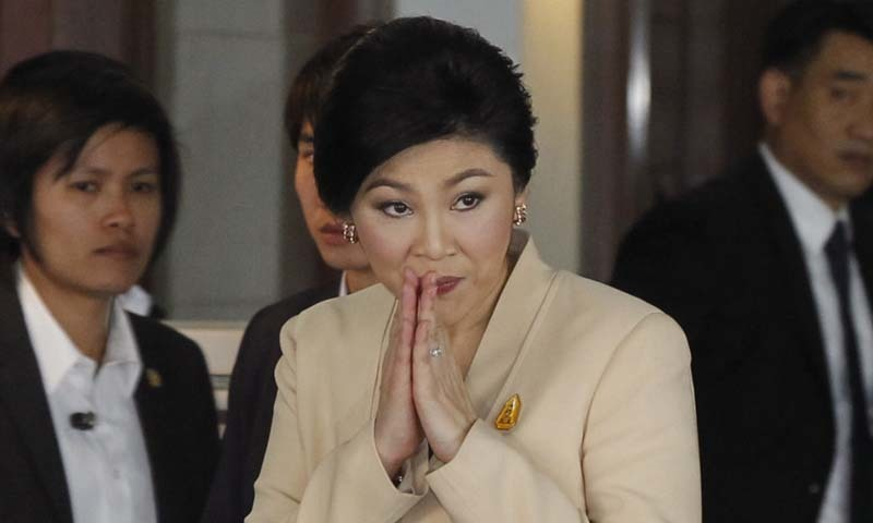 Thailand's ex-PM Yingluck Shinawatra flees country as ten-year jail term looms