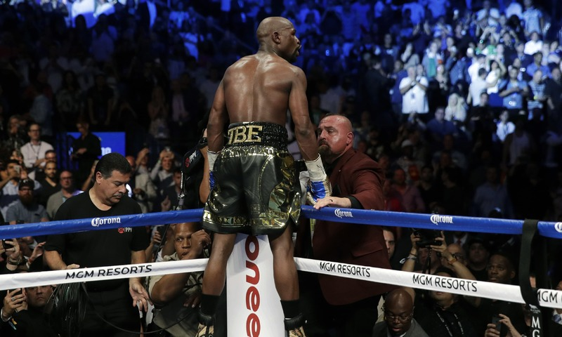 Floyd Mayweather Jr. celebrates after defeating Conor McGregor. —AP