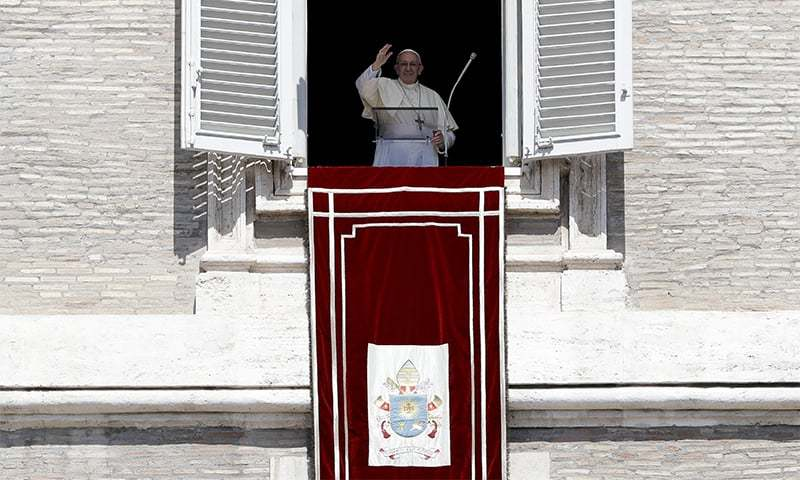 Pope Francis addressing followers at St Peter's Square, at the Vatican. — AP