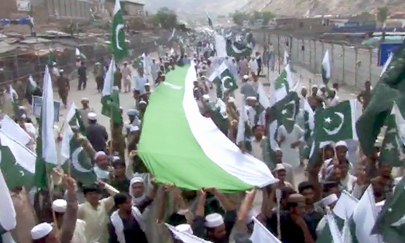 Protesters from Khyber Agency marched their way towards the Torkham border while holding Pakistan flags. — DawnNews
