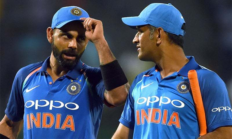 Virat Kohli celebrates with Mahendra Singh Dhoni after victory in the final ODI against Sri Lanka in Colombo. — AFP