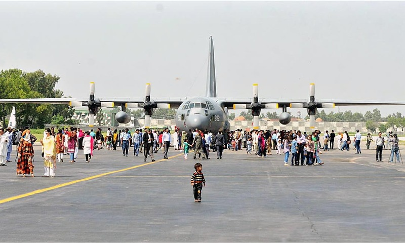 People take a keen interest in aircraft and weapons displayed at Nur Khan Air Base in Rawalpindi. —APP