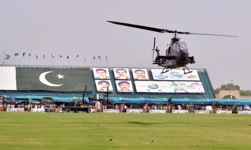 Army Aviation Cobra Gunship helicopter flies past the stands during an event at Fortress Stadium. —Online
