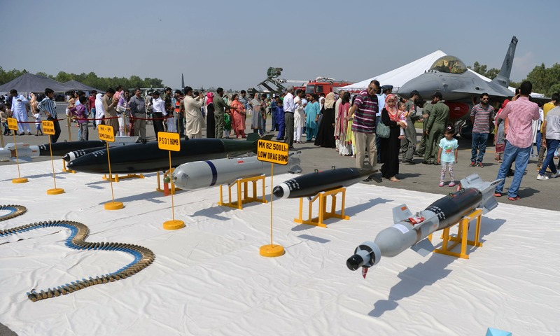 People look at missiles and a fighter jet during celebrations to mark Defence Day at the Nur Khan military airbase in Rawalpindi. —AFP
