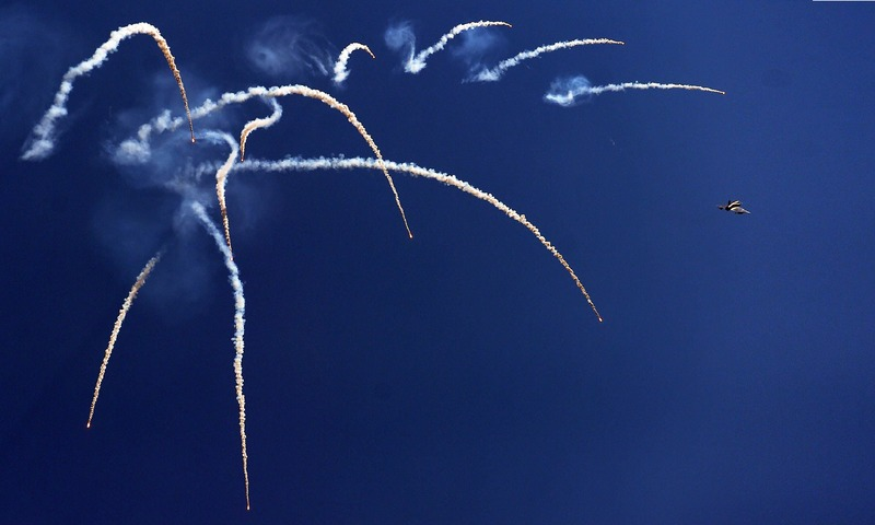 A jet fighter drops flares during celebrations to mark Defence Day at the Nur Khan military airbase. —AFP