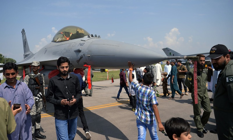 People look at a F-16 jet fighter during celebrations to mark Defence Day at the Nur Khan military airbase in Rawalpindi. —AFP