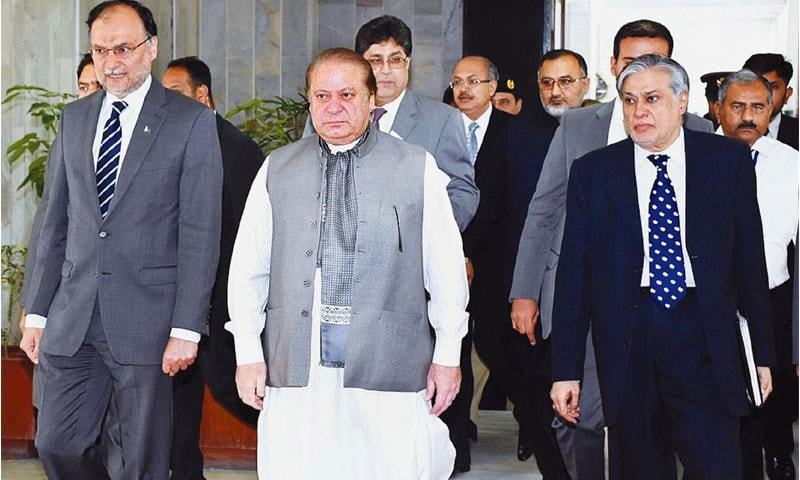 Former prime minister Nawaz Sharif, Finance Minister Ishaq Dar and Interior Minister Ahsan Iqbal arrive to attend a meeting in Islamabad in this 2016 file photo.— APP/File