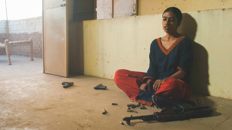 Film still from My Pure Land showing Nazo with the stolen bullets. Photograph: The Guardian (PR)