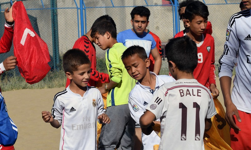 Afghan youth gather to play beach football at Ghazi stadium in Kabul. —AFP
