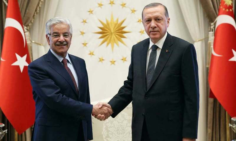 Foreign Minister Khawaja Asif met with Turkish President Recip Tayyep Erdogan on his visit to Turkey on Sept 12. —Photo courtesy FO