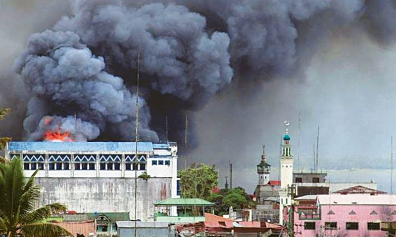 A building in Marawi is set ablaze by air strikes carries out by the Philippine Air Force.
