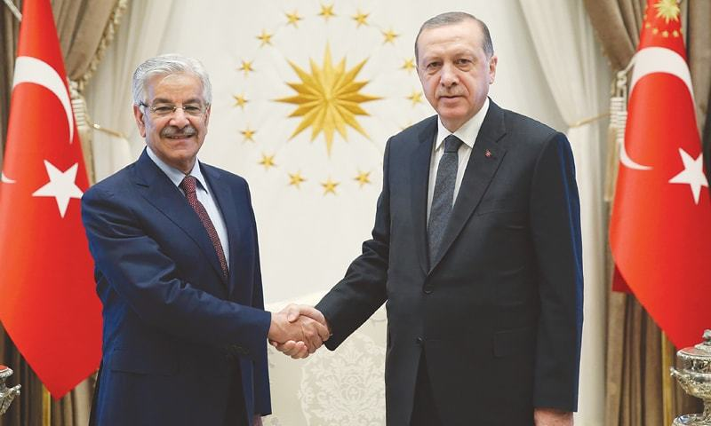 ANKARA: Foreign Minister Khawaja Asif shakes hands with Turkish President Recep Tayyip Erdogan prior to their meeting on Tuesday.—AP