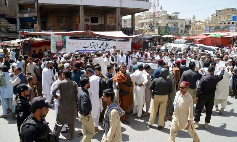 QUETTA: Members of political parties, religious groups and traders' associations hold a demonstration to demand recovery of religious scholar Maulana Ali Muhammad Turab on Tuesday.—PPI
