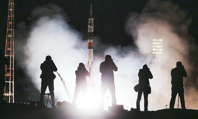 Journalist takes photos of the Soyuz-FG rocket booster with Soyuz MS-06 space ship carrying a new crew to the International Space Station.—AP