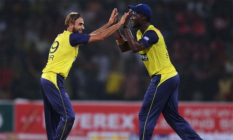 World XI cricketers Imarn Tahir (L) celebrates with teammate Darren Sammy after dismissal of Pakistani batsman Babar Azam during the first Twenty20 international match between the World XI and Pakistan at the Gaddafi Cricket Stadium in Lahore on Sept 12. —AFP/File