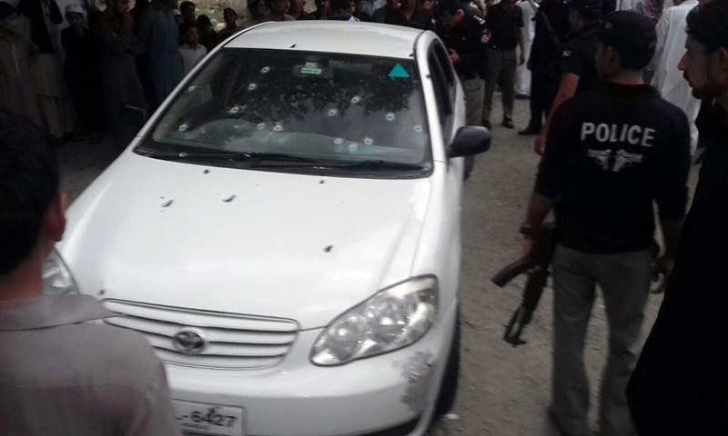 Several bullet holes can be seen spread across the vehicle of the former KP MPA. ─ DawnNews
