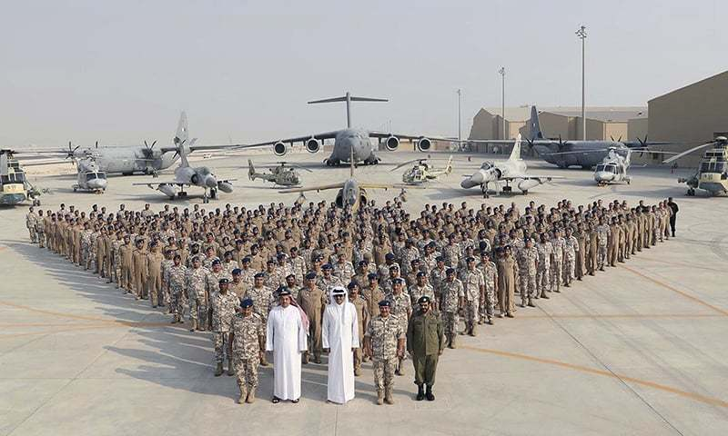 Qatari Emir Sheikh Tamim bin Hamad Al Thani poses for a photo with Emiri Air Force at al-Udeid Air Base in Doha, Qatar.─AP