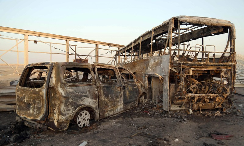 A general view shows burnt out vehicles after the attack in Nasiriyah. —AFP