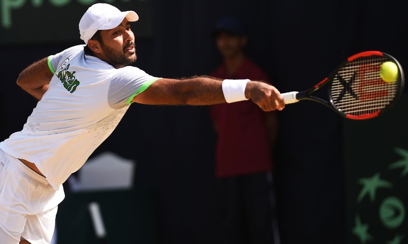 Pakistani Aisam Qureshi returns the ball to Thai opponent Trongcharoenchaikul Wishaya during the Davis Cup Asia-Oceania Group-II Tennis singles final match at the Sports Complex in Islamabad on September 17, 2017. —AFP