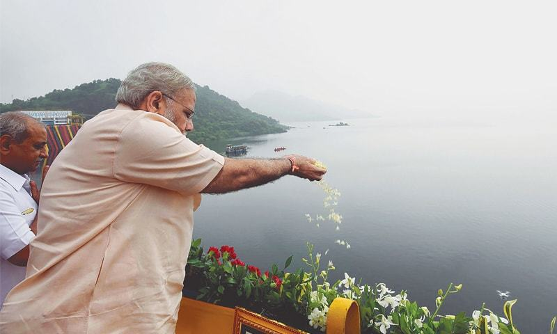 Indian Prime Minister Narendra Modi makes an offering at the site of Sardar Sarovar Dam on Sunday.—AFP