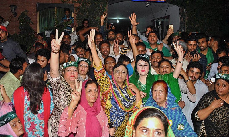Party supporters celebrate the victory of PML-N's candidate Kulsoom Nawaz. —APP